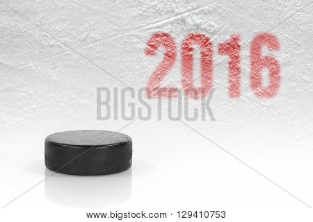 Hockey puck closeup on the ice. Hockey background concept