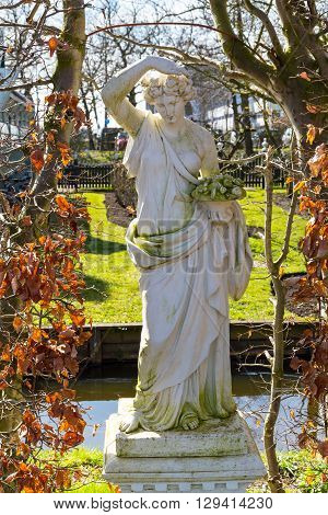 Copy of ancient statue in the garden of Zaanse Schans village, Holland