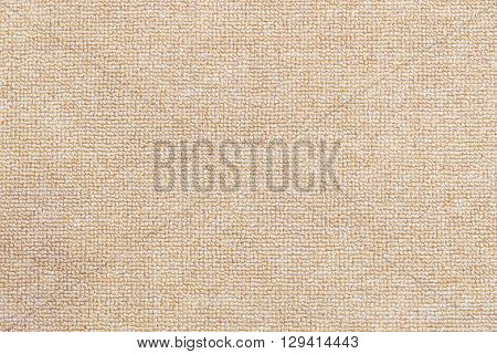 the texture background of the light brown carpet
