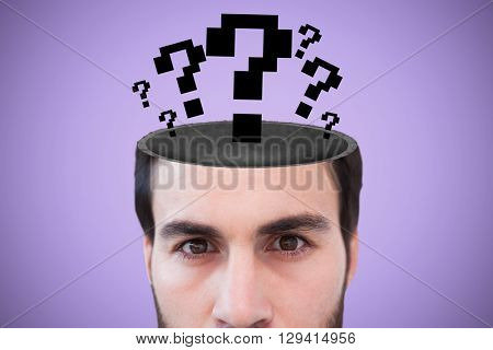 Close up of focused businessman against purple background
