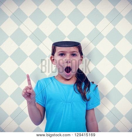 Cute girl shaking finger saying no to the camera against blue and cream patterned wallpaper
