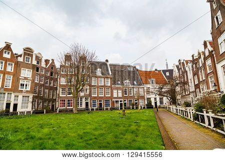Begijnhof courtyard with historic Holland houses in Amsterdam, Netherlands