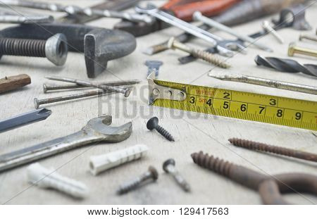 Assorted old work tools on wooden board