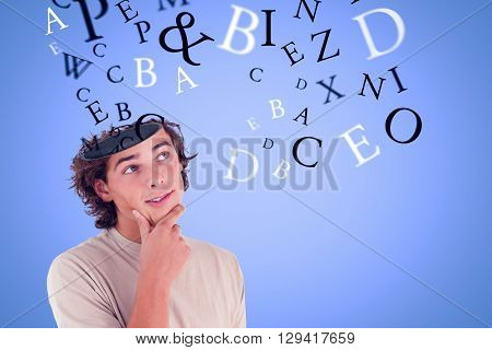 Close up of a thoughtful man against blue background