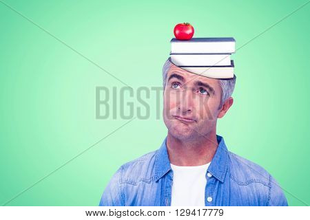 Confused man with grey hair thinking against green background