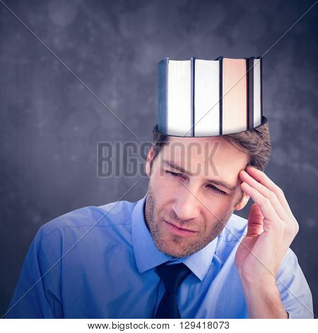 Stressed businessman holding his head against black