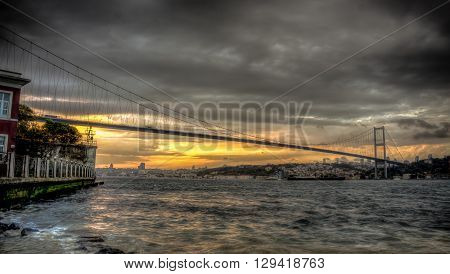 Istanbul, Turkey - 22 October, 2012: Bosphorus bridge connection Asia and Europe on a cloudy evening, Istanbul, Turkey