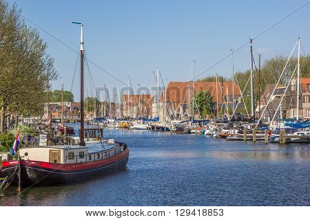 ENKHUIZEN, NETHERLANDS - MAY 9, 2016: Harbor in the enter of historical village Enkhuizen, Netherlands