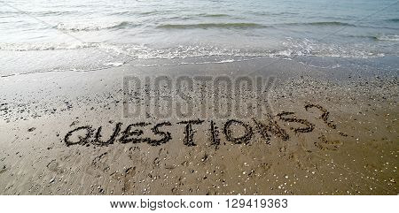 Questions Written In Large Letters On The Sand Of The Sea