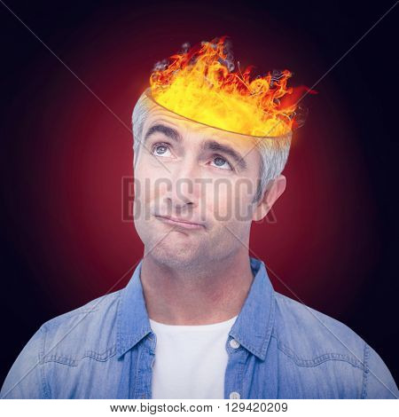 Confused man with grey hair thinking against red background with vignette