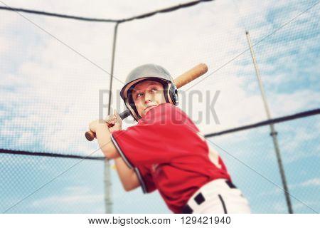 Young baseball player batting