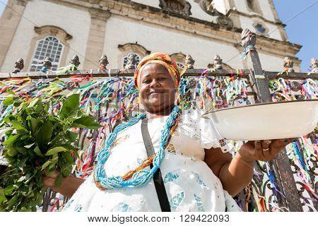 Brazilian woman wearing traditional clothes at Bonfim Church in Salvador, Bahia, Brazil