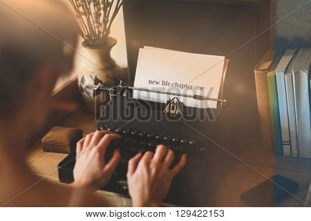 The word new life chapter one against young woman using typewriter