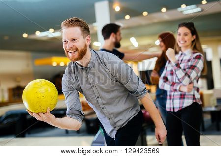Friends enjoying recreational bowling and sport at club