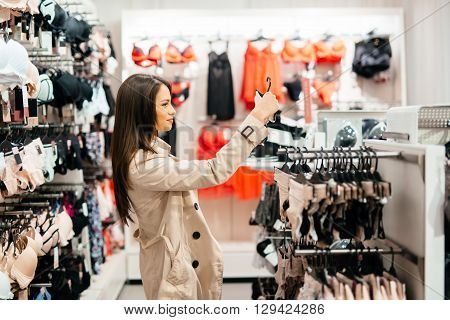 Beautiful young woman shopping lingerie and underware
