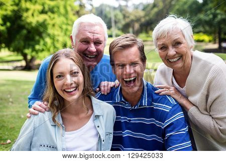 Portrait of happy family having a picnic in park on a sunny day