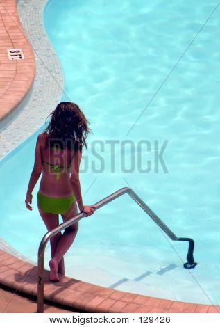 Girl Descending Pool Steps