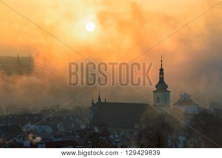 Foggy morning near Church of Our Lady Victorious Prague Czech republic.