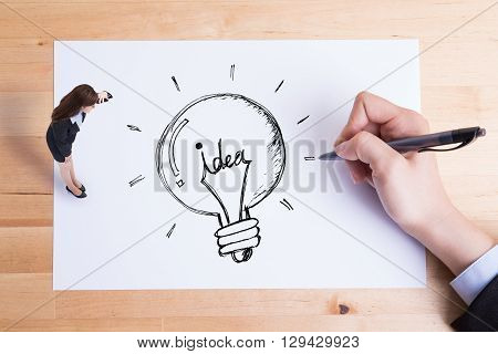 business woman look paper and see idea and light bulb on the paper asian