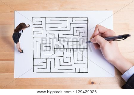 business woman look paper and see hand drawing maze on the paper asian