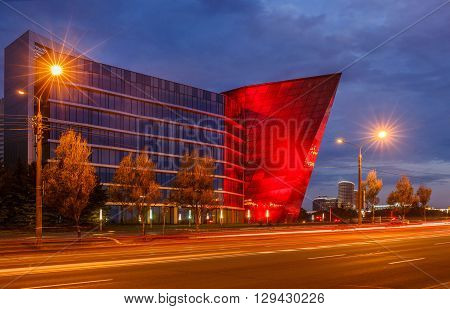 Modern business office building with red lights Minsk, Belarus, like potassium stone