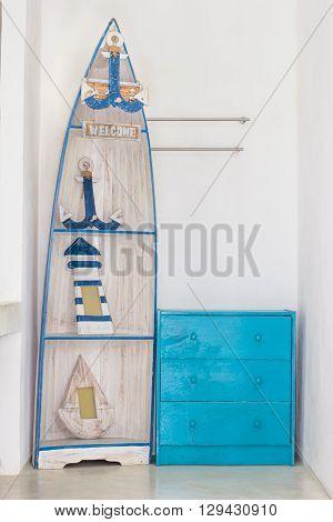blue wooden dresser and boat, furniture decoration