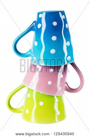 Three colorful polka dot cups turned upside down isolated on white background.