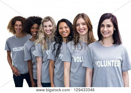 Portrait of happy volunteers standing in a line on white background