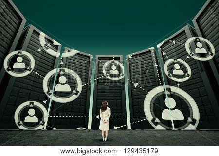 Rear view of businesswoman against dark green sky