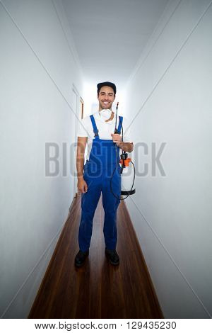 Portrait of pesticide worker standing in hallway at home