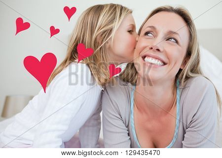Red Hearts against girl giving her mother a kiss
