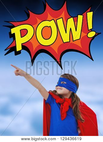 Masked girl pretending to be superhero against white clouds under blue sky