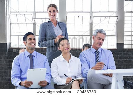 business team taking a note during a meeting against inside a building
