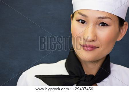 Closeup portrait of a smiling female cook against image of ac chalkboard