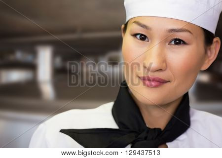 Closeup portrait of a smiling female cook against large vats of beer