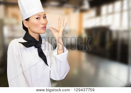 Smiling female cook in the kitchen against no one in the room