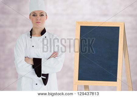 Portrait of confident female chef against image of a wall