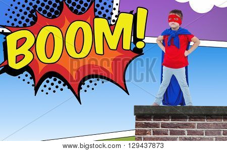 Masked boy pretending to be superhero against the word boom