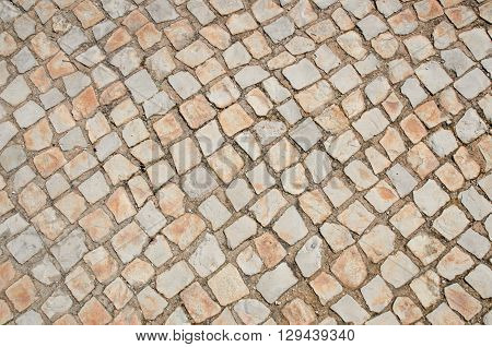 Background of stone paving tiles with square grid pattern