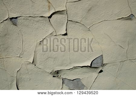 Paint peeling off a stone or concrete background grunge texture.
