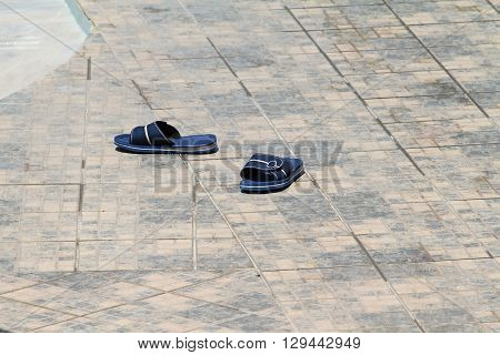 Blue Beach Slippers / Beach Slippers Left on the Pavement