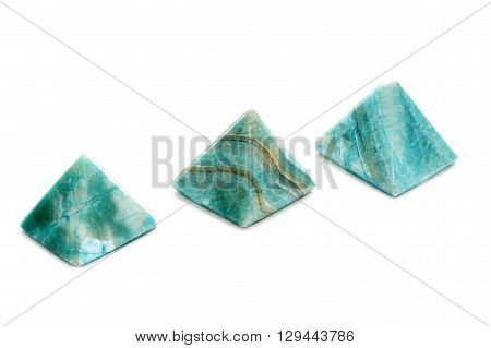 Blue stone pyramids isolated on white background.