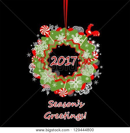 Season greetings with hanging decorative wreath with paper snowflakes and candy