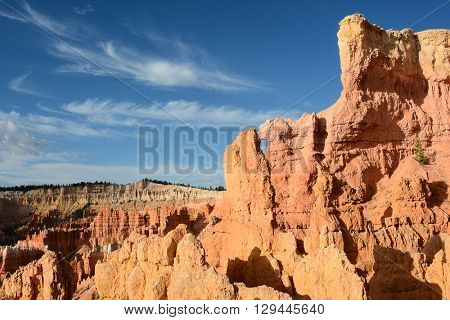 Scenic rock formations in Bryce Canyon National Park. A window rock and blue sky