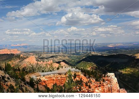 Bryce Canyon landscape in horizontal format with blue cloudy sky.