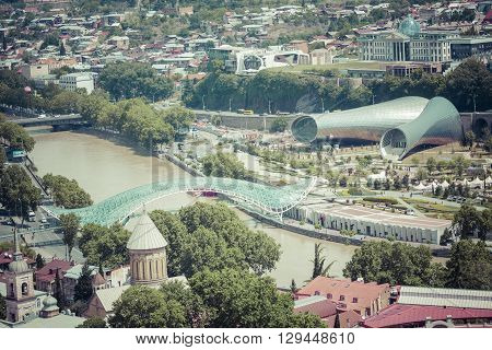 Tbilisi, Georgia - May 07, 2016: People In Apark In Front Of Concert Hall And The Official Residence