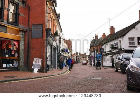 NANTWICH, UK - DECEMBER 29: Shoppers walk down a street of small, independent shops, pubs and restaurants in the town center of historic Nantwich, England on December 29, 2015.
