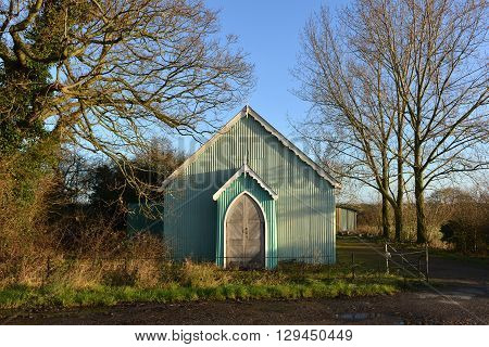 Old green tin tabernacle with oak doors