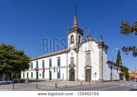 Vila Nova de Famalicao, Portugal. September 06, 2015: Lapa Chapel - a Sacred Art Museum (right), and the Lusiada University branch (left) in Vila Nova de Famalicao, Portugal.
