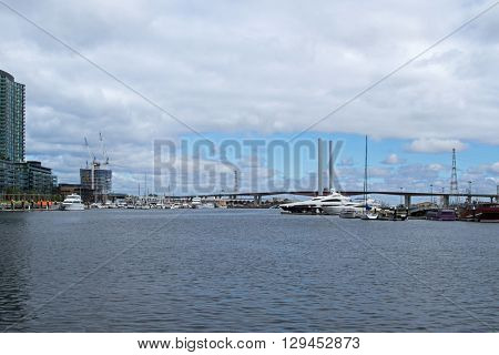 MELBOURNE, AUSTRALIA - APRIL, 2016 : View of Bolte Bridge from the Melbourne Docklands in Melbourne, Victoria Harbour in Australia on April 10, 2016. It is a large twin Cantilever bridge in Melbourne